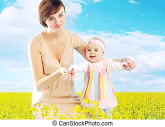 Charming mother hugging little daughter