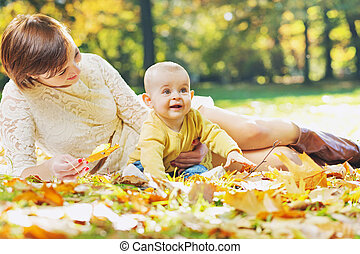Charming mother looking after baby - Charming mother looking...