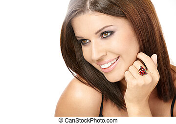 Portrait of the beautiful smiling woman with a ring on a finger, isolated