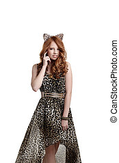 Charming red-haired girl posing in catwoman outfit