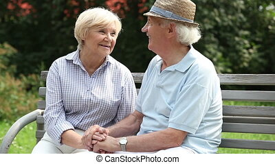Charming retirees - Happy retired couple enjoying each...