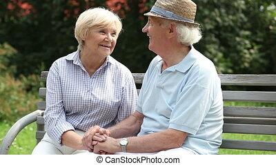 Charming retirees - Happy retired couple enjoying each...