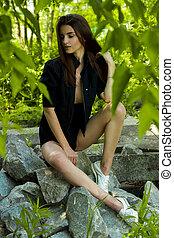 charming sensual girl posing on the rocks