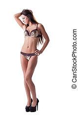 Charming slim woman posing in erotic underwear