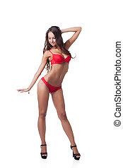 Charming slim woman posing in red underwear