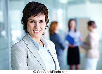 Charming specialist - Image of smiling female looking at ...