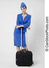 Charming Stewardess Dressed In Blue Uniform And Suitcase