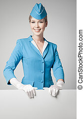 Charming Stewardess Dressed In Blue Uniform With Blank Form On Gray Background