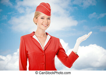 Charming Stewardess Dressed In Red Uniform Holding In Hand. Sky