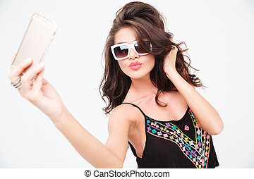 Charming stylish woman making selfie photo