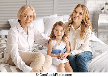 Charming three generations of women bonding - Enjoying...