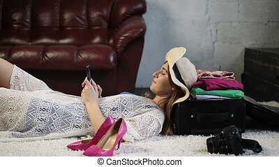 Charming tourist woman using mobile phone at home