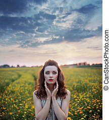 Charming woman among wild-flowers fields - Charming lady...