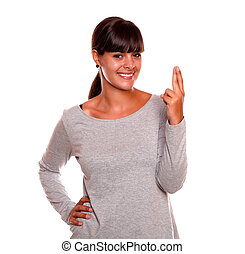 Charming woman crossing her fingers for luck