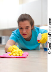 Charming woman doing cleaning at home