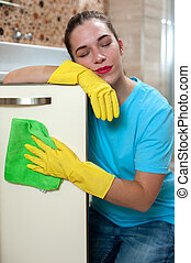 Charming woman doing cleaning - Tired but pleased. Young...