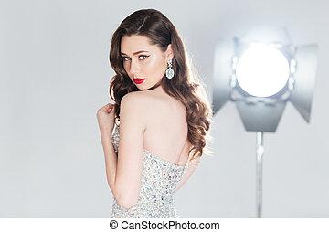 Charming woman in fashion dress