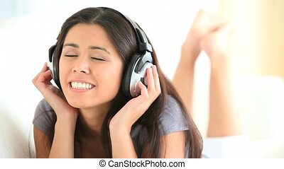 Charming woman listening to music