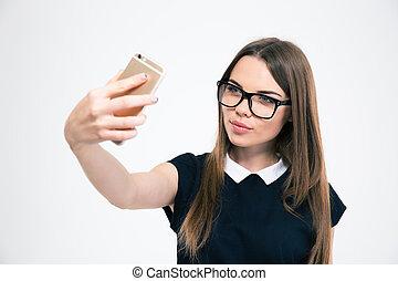 Charming woman making selfie phot