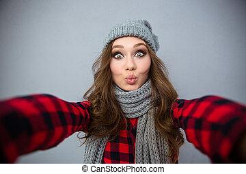 Charming woman making selfie photo