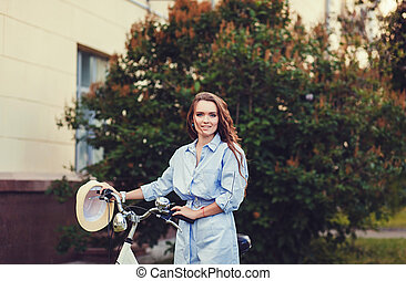 woman on bike in city