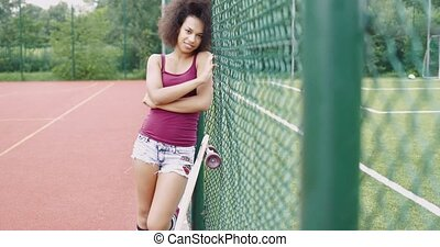 Charming woman on sports ground - Pretty young ethnic woman...