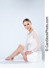 Charming woman posing in white dress
