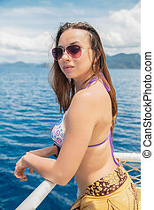 Charming woman posing on a yacht