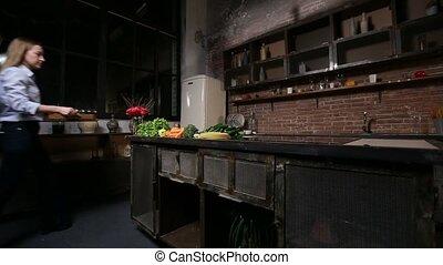 Charming woman preparing smoothie in kitchen