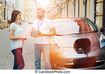 Charming woman providing her data for e-car rent