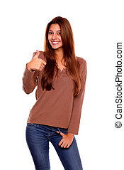 Charming woman smiling and showing you ok sign
