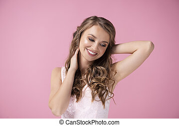 Charming woman smiling in the studio shot