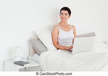 Charming woman using a laptop