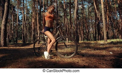 charming woman with a Bicycle