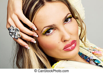 Charming woman with luxury jewelry
