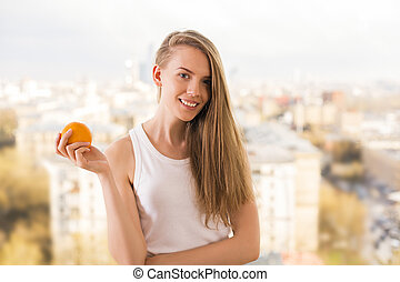 Charming woman with orange
