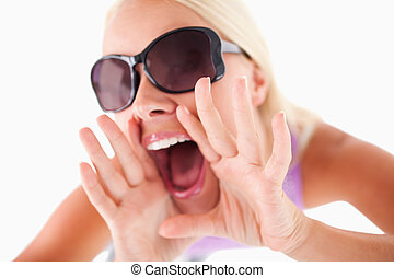 Charming woman with sunglasses in high spirits in a studio