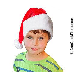 Charming year-old boy in red Santa hat posing