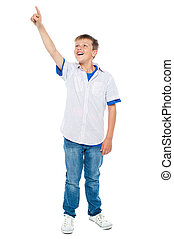 Charming young boy pointing towards copyspace area