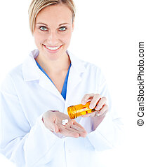 Charming young doctor holding pills