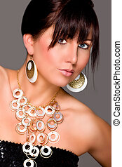 Charming young girl with beautiful jewelry. Retouched