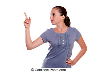 Charming young isolated woman pointing up