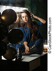 Charming young lady posing while sitting