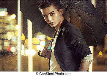 Charming young model with umbrella