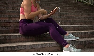 Sportswoman In Sports Suit With Headphones