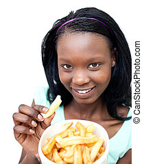 Charming young woman eating fries against a white background