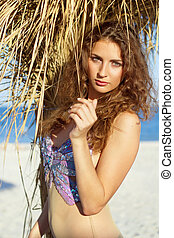 Charming young woman on a beach