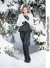 Charming young woman posing in winter