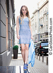 Charming young woman posing outdoors