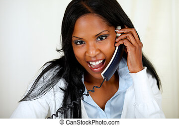 Charming young woman speaking on phone